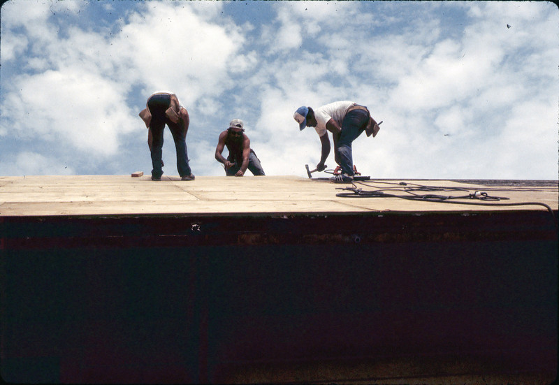 Installing plywood for new roof, 6/1982. acc2005.001.0251