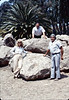 Phyllis Olsen, Jesse Garcia, and Al Jaramillo pose in front of the rock that will bear the Native Sons plaque at Goleta Depot, 8/1983, acc2005.001.0395.