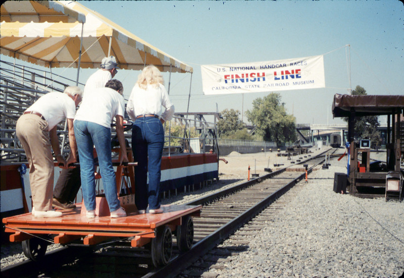 Handcar race team members - George Adams, Anna Dato, Gene Allen, and Phyllis Olsen - at Calif. State Railroad Museum, Sacramento, 9/18/1987 acc2005.001.0868