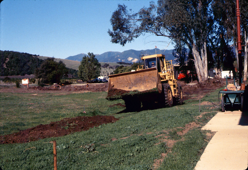 Banner Construction crew grades in preparation for standard-gauge track construction in front of Goleta Depot, 1/1985. acc2005.001.0465C