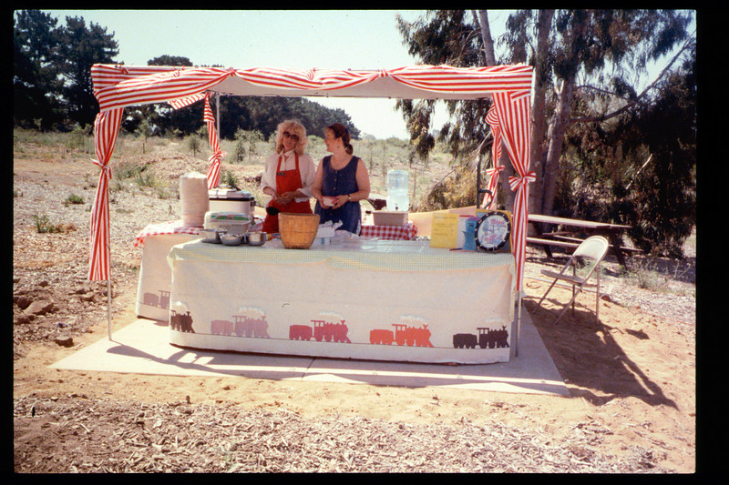 This is the food booth for the Steaming Summer (June 25, 1994) event (Phyllis Olsen and Mary Cole). Other 1994 Steaming Summer dates were July 23 and Aug. 27. acc2005.001.1958