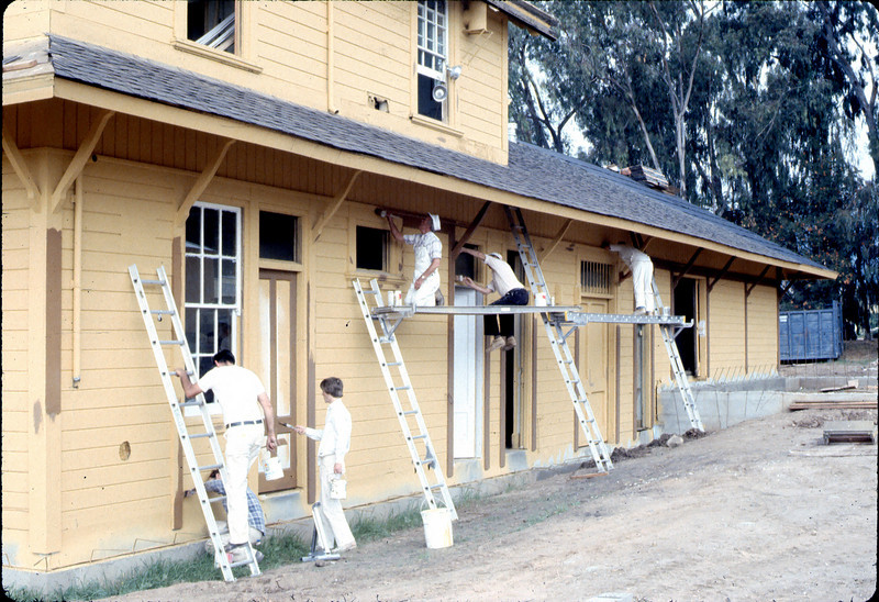 Painter's Union men return to apply trim, 9/1982. acc2005.001.0316