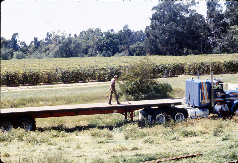 Laying of the standard-gauge track (Gene Allen on truck), 4/2/1985 acc2005.001.0485