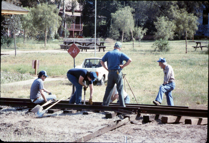 Track extension construction crew -- Ralph Moore, Gene Boswell, Malcolm Alexander, Scott Moore, and Perry Adams, 4/18/1987. acc2005.001.0759