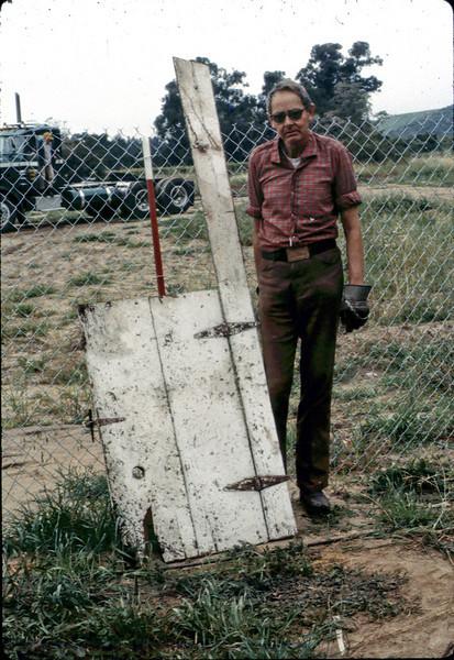 Gene Allen with attic door. acc2005.001.0209