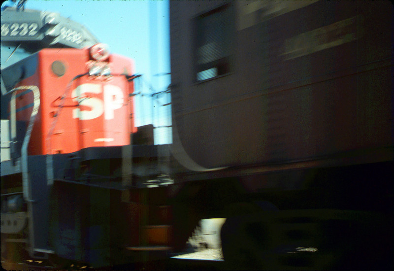 Caboose 4023 hurtles by on eastbound local west of Dos Pueblos, 9/21/1986 acc2005.001.0598