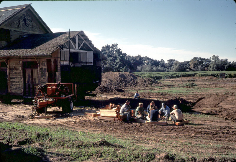 First day at new site, 11/19/1981. Movers enjoy some wine and refreshments. acc2005.001.0096