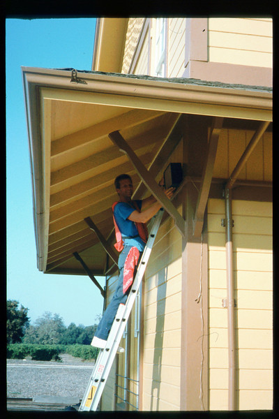 SWAP worker Steve Crane works on PA-system speakers, Summer-Fall 1993. acc2005.001.1874