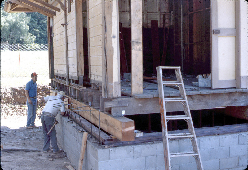 Carpenters perform structural repairs, 3/1982. acc2005.001.0190