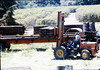 Laying of the standard-gauge track (Ed Lebeck on forklift), 4/2/1985 acc2005.001.0480E