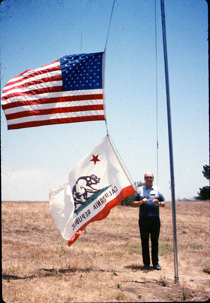 Bev Casselman raises the flags at the museum, 6/1987 acc2005.001.0813