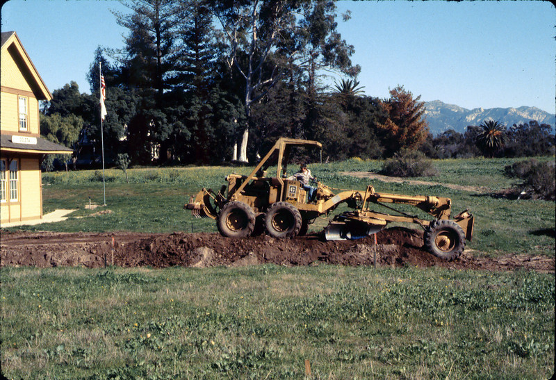 Banner Construction crew grades in preparation for standard-gauge track construction in front of Goleta Depot, 1/1985. acc2005.001.0465D
