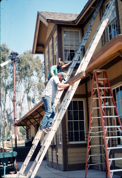 M&M Construction installs new redwood gutters, 5/1988. acc2005.001.0979