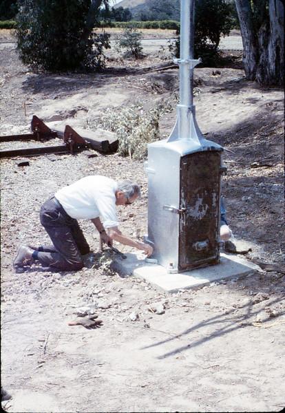 Gene Allen installs the wig-wag signal, 5/1989 acc2005.001.1180