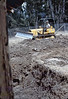 County worker backfills foundation, 6/1982. acc2005.001.0261