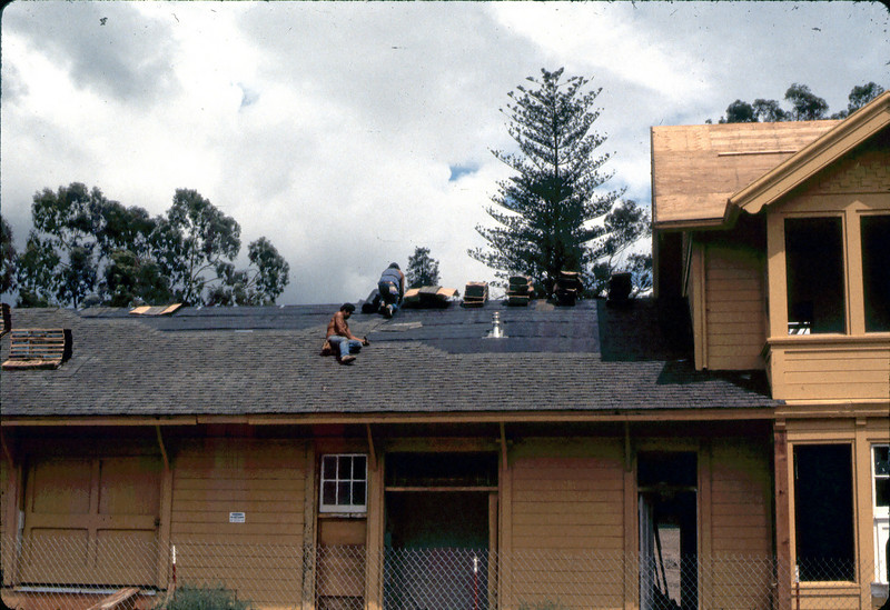 "Installing the new roof. ""Fernando"" and co-workers, 9/1982. acc2005.001.0306"