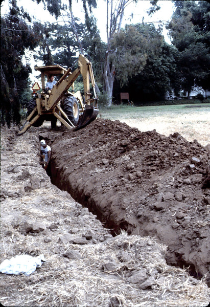 Trenching for building utilities, 6/1982. acc2005.001.0243