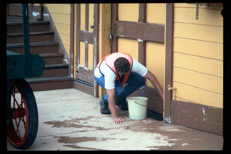 County SWAP worker preps Goleta Depot's window bay for eventual painting, 1995. acc2005.001.2076