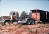 Caboose body is moved by truck onto museum grounds, 9/25/1986 acc2005.001.0632