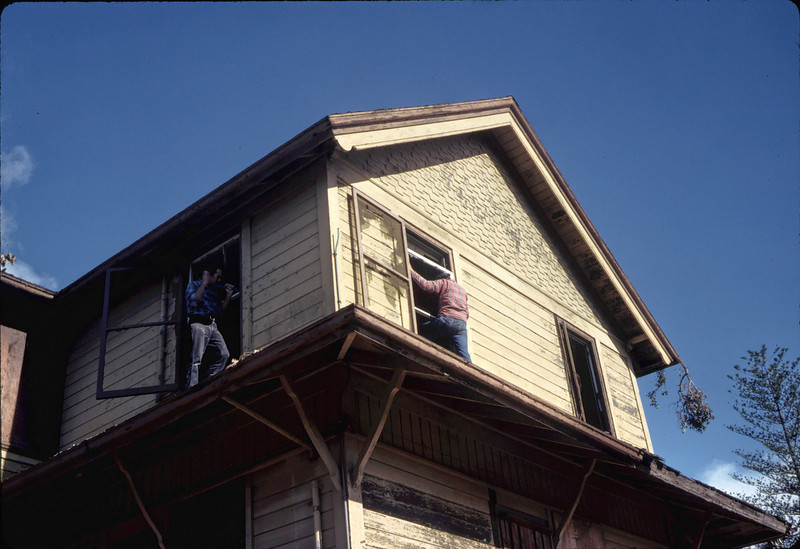 Window & screen removal. Michael Glassow (left), 11/28/1981. acc2005.001.0124