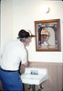 Volunteer Malcolm Alexander cleaning in the restrooms, 2/21/1987 acc2005.001.0703