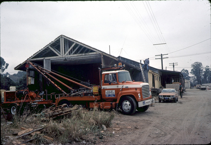 Work begins on small section of building, 11/13/1981. acc2005.001.0053