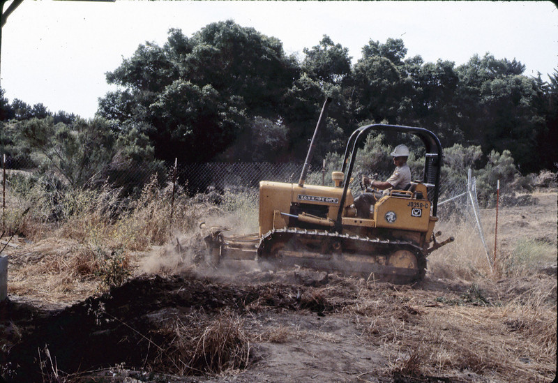 County worker backfills foundation, 6/1982. acc2005.001.0255