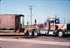 Caboose body is moved by truck from La Patera to museum grounds, 9/25/1986 acc2005.001.0626