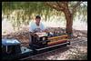 "John Locke helps decorate ""El Tren de la Fiesta,"" Aug. 6, 1994. acc2005.001.1988"