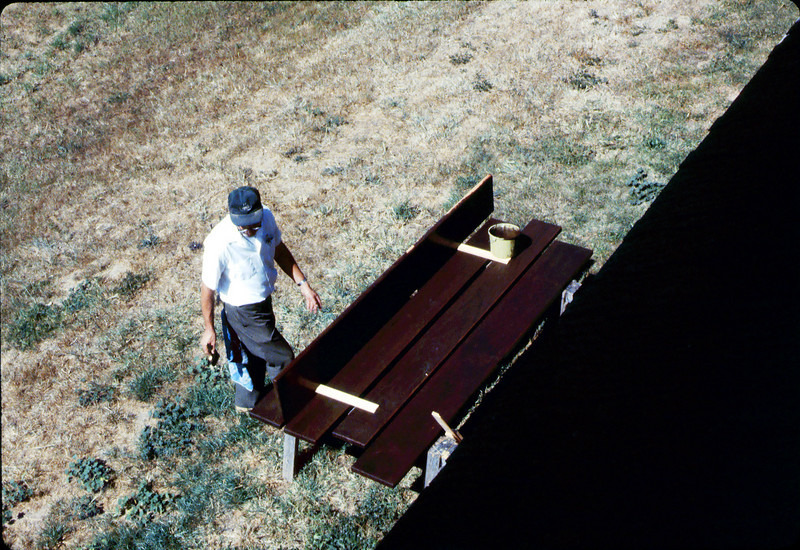 Ralph Moore paints a picnic table he built and donated to the museum, 1984. acc2005.001.0453