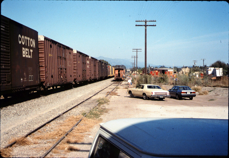 X7545 east-bound local delivers Caboose 4023 to La Patera spur, 9/21/1986 acc2005.001.0601