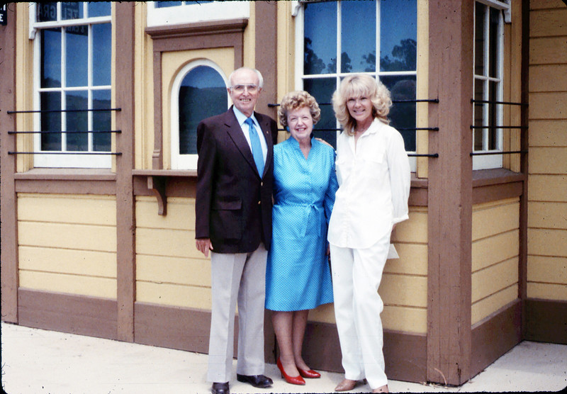 Earl and RoseAnn Hill pose with Phyllis Olsen on occasion of creation of Children's Education Fund, 1989. acc2005.001.1192