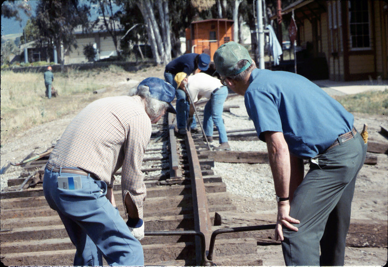 Track extension construction crew -- Ralph Moore, Gene Boswell, Malcolm Alexander, Scott Moore, and Perry Adams, 4/18/1987. acc2005.001.0749