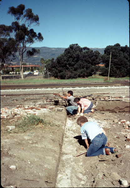 Salvaging bricks from old depot site, 11/19/1981. Nancy Ried & Mary Lou Williamson. acc2005.001.0109