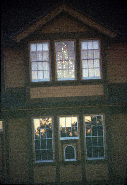 Goleta Depot front exterior with Christmas tree in upstairs bay, 12/1988. acc2005.001.1031