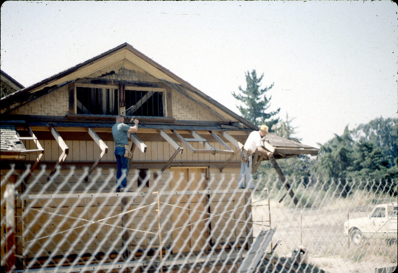 Carpenters Paul and Louie repairing eave, 6/1982. acc2005.001.0215