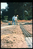 Gene Allen and Ronald Ferguson work on miniature-train expansion which will add 600 feet to route, Summer 1994. acc2005.001.2010