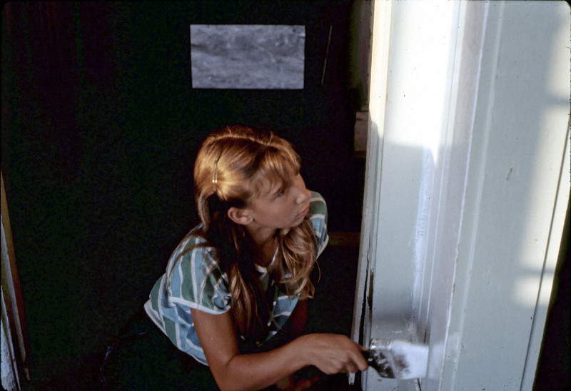 Stephanie Coombs applies paint upstairs, 7 or 8/1982. acc2005.001.0273