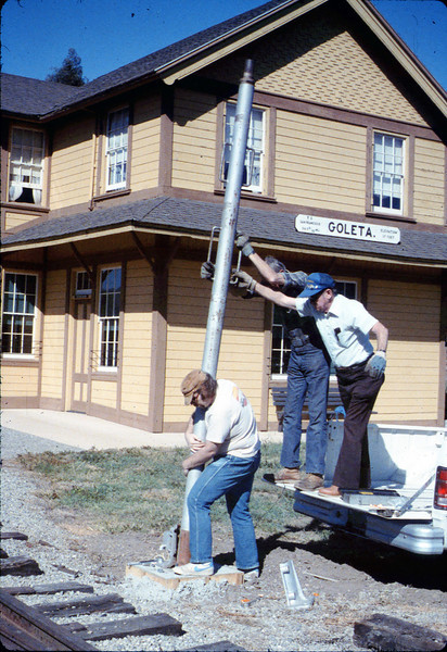 Gene Allen, Glen Apers and Glen's son install train-order post, 2/1987. acc2005.001.0690