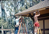 M&M Construction installs new redwood gutters, 5/1988. acc2005.001.0959