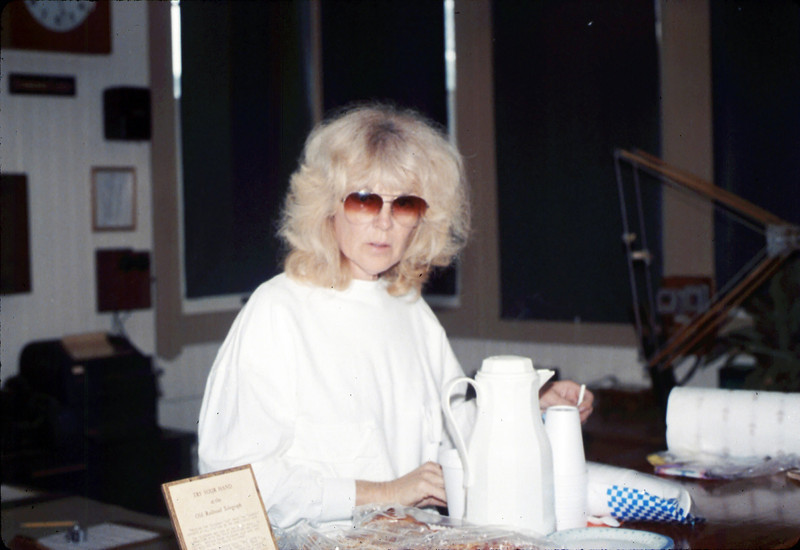 Work Day (Phyllis Olsen preparing coffee), 1/1990. acc2005.001.1245