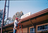 M&M Construction installs new redwood gutters, 5/1988. acc2005.001.0974