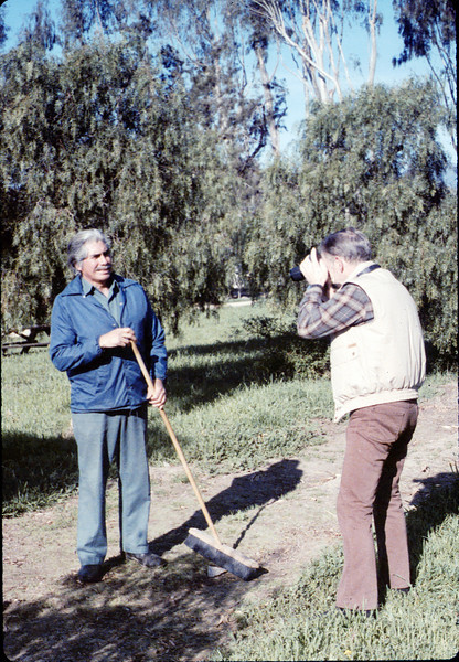 Photographer Paul Heuston captures volunteer Al Jaramillo at work, Work Day, 3/1988. acc2005.001.0904