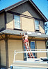 M&M Construction installs new redwood gutters, 5/1988. acc2005.001.0962