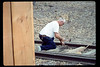 Elmer Coombs works on handcar loading/transfer platform, 7/1990 acc2005.001.1386