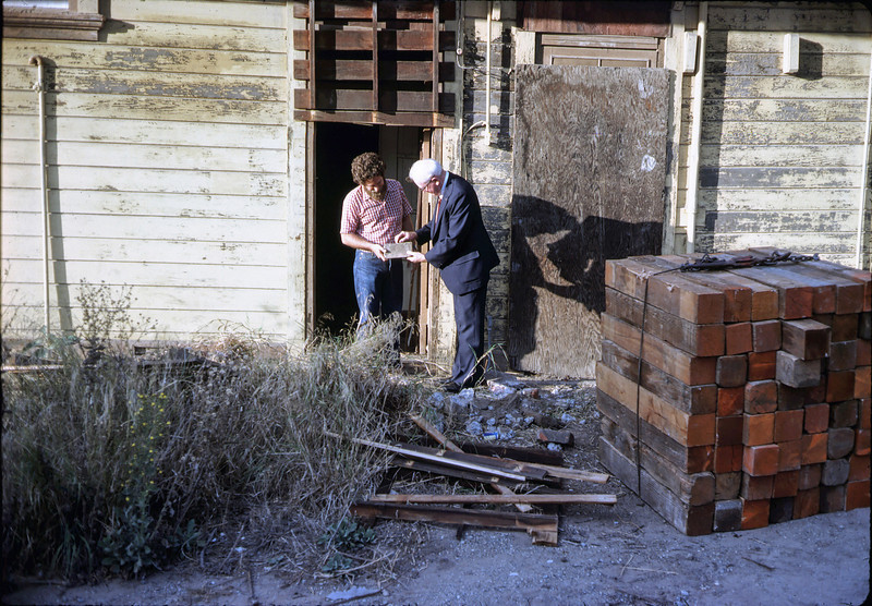 Gary Coombs and Steve Sullivan examine a foundation brick found at depot site, 11/10/1981. acc2005.001.0022