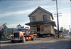 """Oakie"" pulling two-story section of building away from foundation, 11/12/1981. acc2005.001.0031"