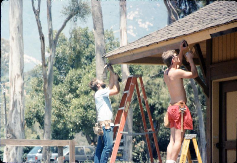 M&M Construction installs new redwood gutters, 5/1988. acc2005.001.0960
