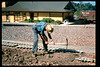 Gene Allen works on miniature-train expansion which will add 600 feet to route, Summer 1994. acc2005.001.1984