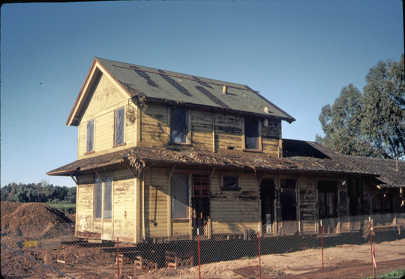 Plastic sheeting covered window openings, 11/28/1981. acc2005.001.0127